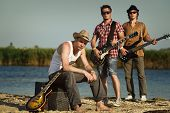 image of hillbilly  - Three men with guitars on the river - JPG