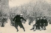 RAWICZ, POLAND, CIRCA FORTIES - Vintage photo of man pulling sled with three women, Rawicz, Poland,