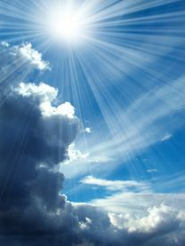 stock photo of sun rays  - Blue cloudy skies and rays of a sun - JPG