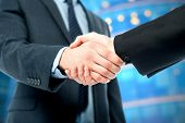 picture of handshake  - Cropped image of business handshake the deal Is finalized - JPG