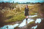 foto of girl walking away  - girl going on rural road in time a rain - JPG