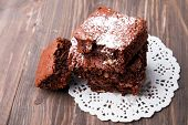stock photo of brownie  - Delicious brownies on the wooden table close - JPG