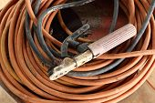 stock photo of welding  - Welding electrode holder with attached electrode wire - JPG