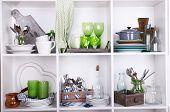 stock photo of kitchen utensils  - Kitchen utensils and tableware on beautiful white shelves - JPG