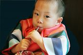 foto of hanbok  - Korean baby dressed in hanbok for his first birthday