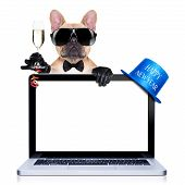 picture of french toast  - french bulldog dog ready to toast for new years eve behind a laptop pc computer isolated on white background - JPG