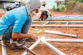 stock photo of turban  - welder with turban is welding in Thailand - JPG