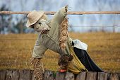 stock photo of scarecrow  - Old scarecrow in the farm made form hay and old clothing - JPG