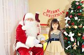 pic of letters to santa claus  - Little cute girl giving letter with wishes to Santa Claus near Christmas tree at home - JPG