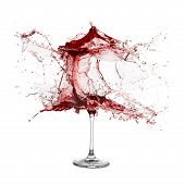 picture of red wine  - Explosion of a glass with red wine on a white background - JPG