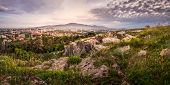 stock photo of calvary  - Village under a Hill at Sunrise - JPG