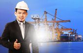 foto of ship  - young manager man standing and sign good quality control of port shipping import export and logistic industry service against ship in comercial ship piers - JPG
