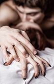 image of intimate  - Young beautiful amorous couple making love in bed - JPG