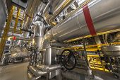 foto of thermal  - Large industrial pipes in a thermal power plant - JPG