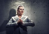foto of halo  - Young saint businesswoman with halo above head - JPG