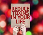 pic of reduce  - Reduce Toxins In Your Life card with colorful background with defocused lights - JPG