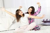 pic of pajamas  - Beautiful girls twins in pajamas at home - JPG
