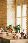 stock photo of wedding feast  - Amazing design wedding table by the window in the room - JPG