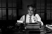 pic of 1950s style  - Professional reporter at work writing down notes 1950s style office - JPG