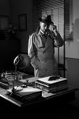 pic of 1950s  - Attractive detective standing next to his desk 1950s style office - JPG