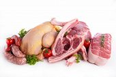 stock photo of raw chicken sausage  - assorted raw meats - JPG