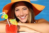 image of bathing  - Happy woman with perfect white smile in vacations bathing in a pool and looking at camera - JPG