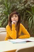 stock photo of canteen  - Young female college student doing homework in outdoor canteen - JPG