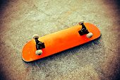 image of skateboarding  - closeup of one empty skateboard on floor - JPG