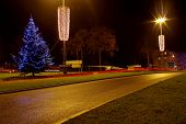 pic of light-pole  - The photo shows a Christmas tree decorated with electric lights shining light blue color - JPG