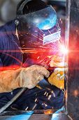 picture of welding  - worker welding steel construction by MIG welding process - JPG