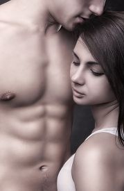 stock photo of intimate  - Young beautiful couple in each other - JPG
