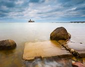 image of hitler  - Beautiful view on Baltic rocky coast with old military buildings from world war II and wooden breakwaters - JPG