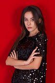 pic of little black dress  - Beautiful brunette girl in a black dress with brown eyes - JPG