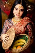 stock photo of sari  - beauty sweet real indian girl in sari smiling holding food - JPG
