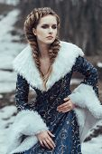 pic of coat  - The woman in blue coat walking in forest - JPG