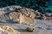 stock photo of road construction  - Construction process of the road next to the ocean - JPG