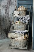 image of little angel  - Background rustic veranda with a shelf with baskets and angels. Old decorations and wooden walls ** Note: Shallow depth of field - JPG
