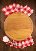 foto of cutting board  - pizza cutting board on wooden background - JPG