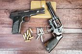 picture of guns  - Black revolver gun and Semi - JPG