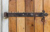 stock photo of wooden door  - Old wooden door with an old cast iron door hinges - JPG