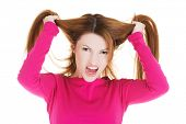stock photo of pulling hair  - Frustrated and angry woman pulling her hair - JPG