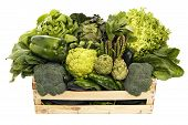 foto of escarole  - Wooden box with assorted green vegetables isolated on white - JPG