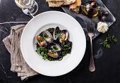 stock photo of clam  - Seafood pasta with clams Spaghetti Vongole on white plate on dark marble background - JPG