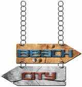 image of directional  - Wooden directional sign with two arrows in opposite direction hanging with metal chain with text beach and city - JPG