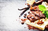 stock photo of vanilla  - Assortment of fine chocolates and pralines with fresh mint and vanilla - JPG