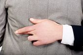 foto of fingers crossed  - Businesswoman fake fingers crossed while embracing - JPG