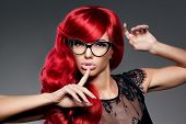 stock photo of beautiful lady  - Luxury fashion trendy  young  woman with red curled hair in glasses - JPG