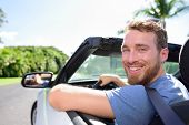 stock photo of road trip  - Driving car man happy on road trip travel holidays - JPG