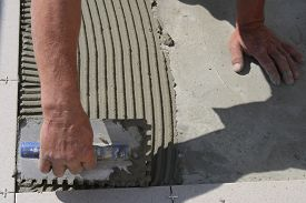 pic of grout  - On this picture is hands - JPG
