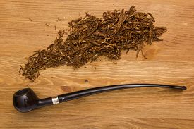 pic of tobacco-pipe  - Women tobacco pipe with a long shank and tobacco - JPG
